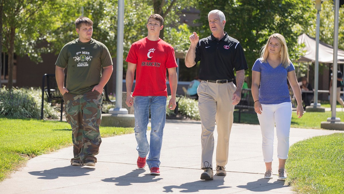 Dean Jeff Bauer walking with students