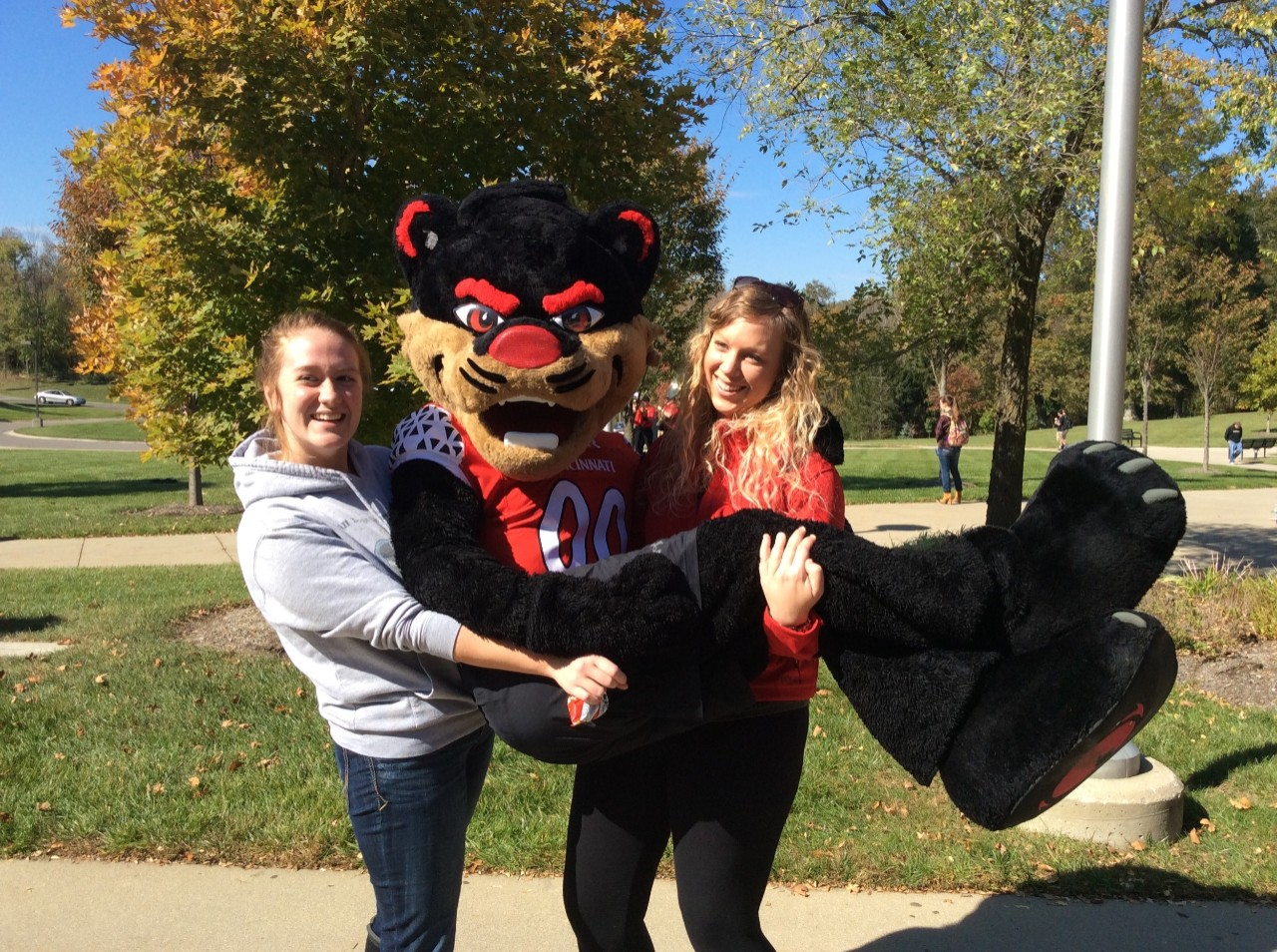 students holding Bearcat