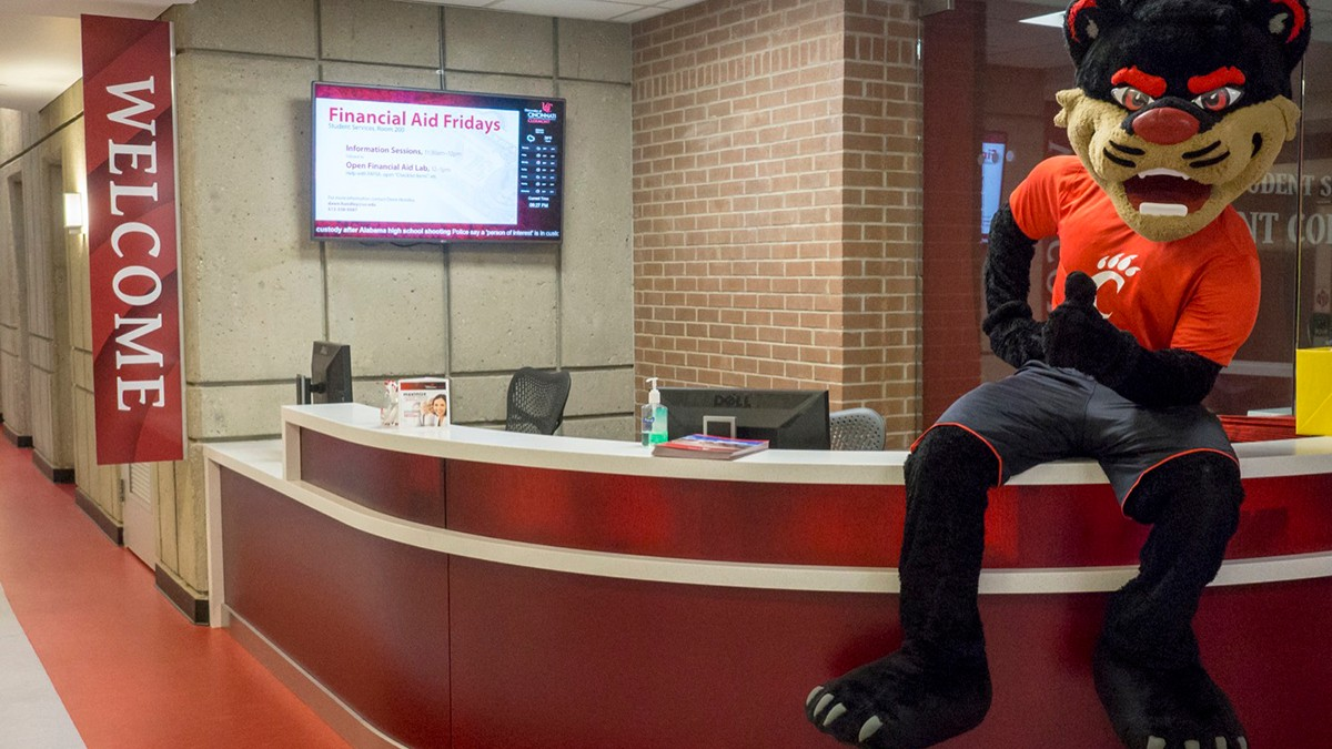 UC Bearcat sits on the UC Clermont Welcome Desk